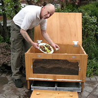 George Pilkington demonstrates the WasteBuster Wormery
